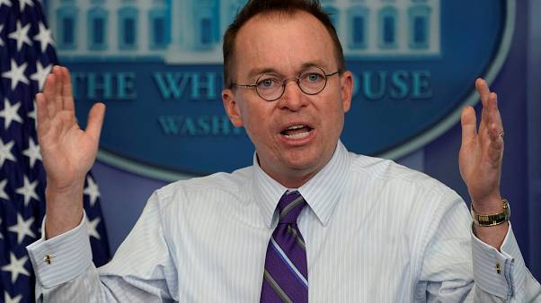 Image: White House budget director Mick Mulvaney  speaks during a news brie