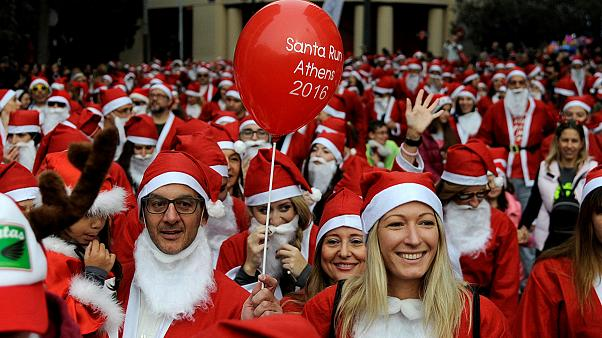 Festive fun as sea of Santas hits Athens' streets