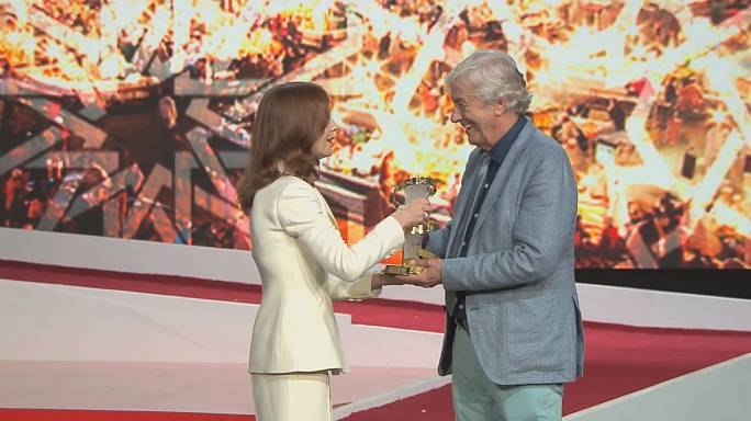 Actress Isabelle Huppert pays tribute to director Paul Verhoeven at the Marrakech Film Festival