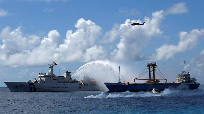 South China Sea: Beijing defiant over weapons deployment claims
