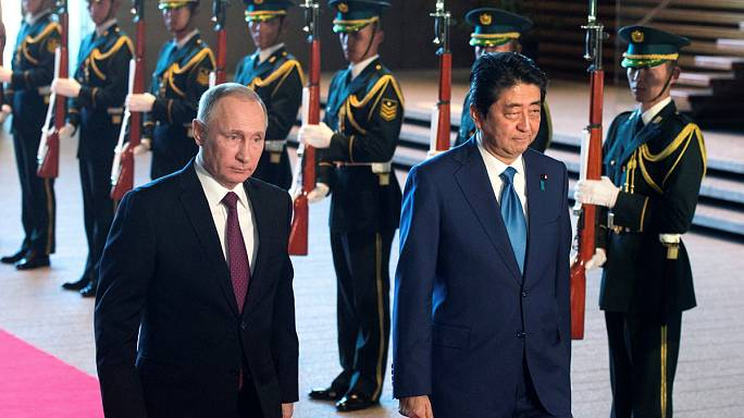 Japan and Russia sign trade deals but remain marooned over islands