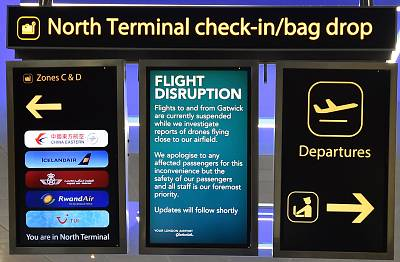 An information board announces flight disruption at London Gatwick Airport, south of London on Dec. 20, 2018 after all flights were grounded due to drones flying over the airfield.
