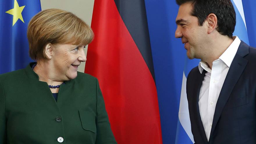 Tspiras, Merkel differ over Greek Christmas giveaway