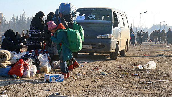 Syria: people leave rebel-besieged villages as evacuations step up