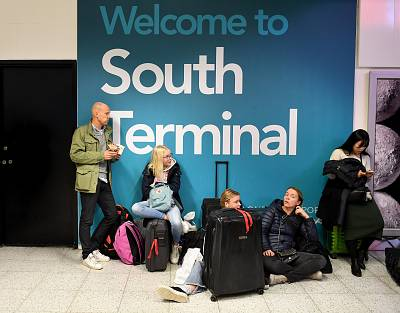Passengers wait for information on delayed flights at Gatwick Airport on Thursday.