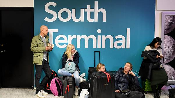 Passengers wait for information on delayed flights at Gatwick Airport on Th