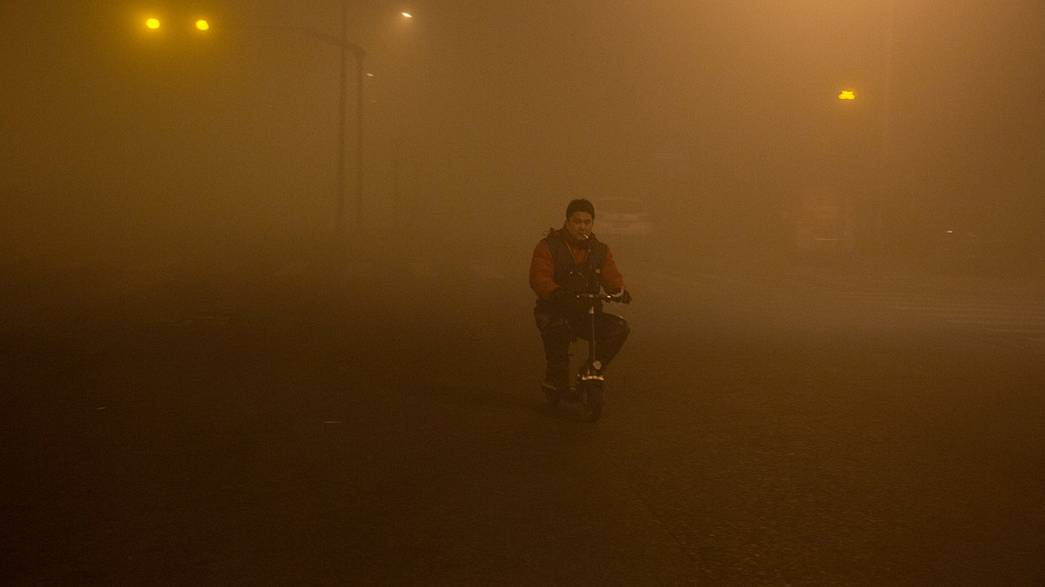 Air pollution forces Chinese slowdown as cities close factories and ban flights
