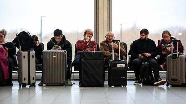 Image: Passengers wait in the South Terminal building at London's Gatwick A