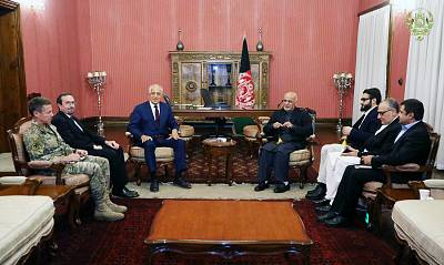 Afghanistan\'s President Ashraf Ghani, seated right, and U.S. special envoy for peace in Afghanistan, Zalmay Khalilzad, meet in Kabul on Nov. 10.