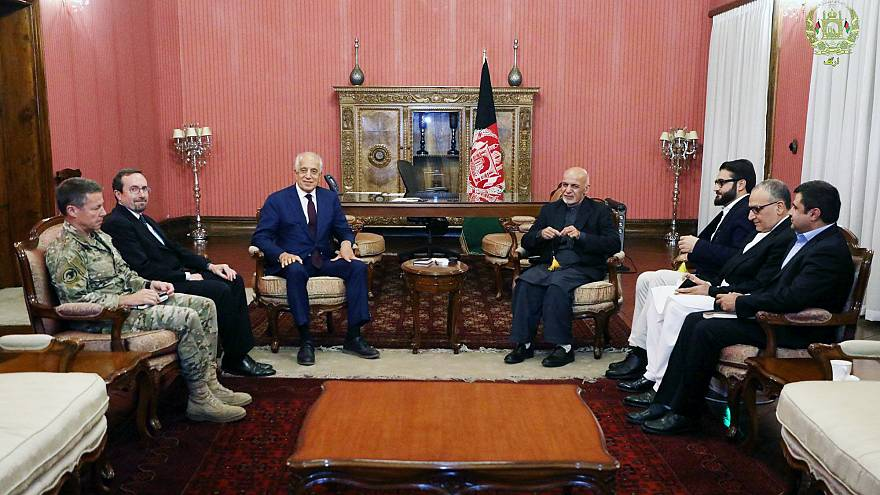 Afghanistan's President Ashraf Ghani, right, and U.S. special envoy for pea