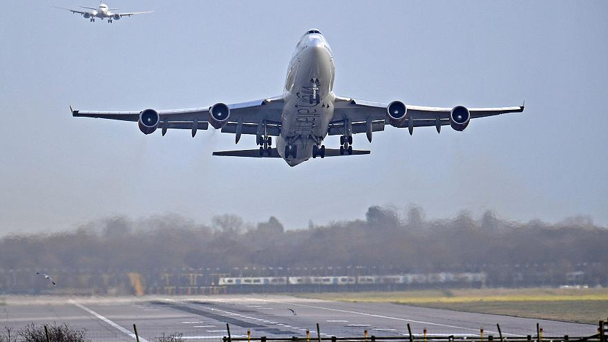 Image: An airplane takes off at Gatwick Airport, after the airport reopened