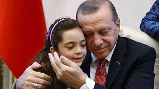 [Photos] 7-year-old Syrian twitter star meets Erdogan after Aleppo rescue