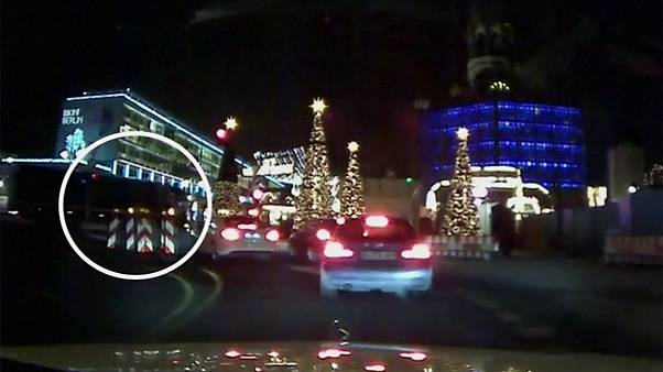 International hunt for Berlin suspect continues as dashcam shows attack for the first time