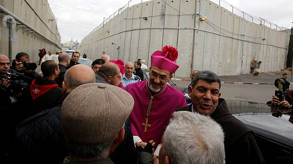 Christmas Eve crowds flock to Bethlehem
