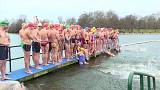 Swimmers brave elements for festive Serpentine dip