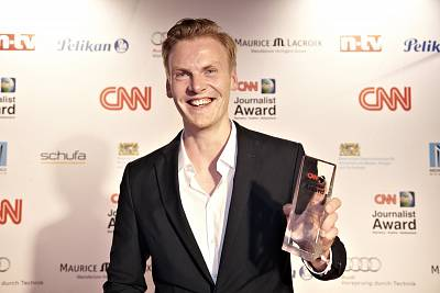 German journalist Claas Relotius holds his trophy for the CNN Journalist Award 2014, which was stripped from him this month when he admitted to fabricating details in stories.