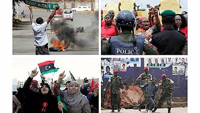2016 Review: [12 Top Photos] Protests across Africa – flowers, police, flags etc.
