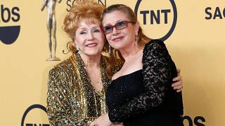Tributes redouble as Debbie Reynolds joins daughter in posterity
