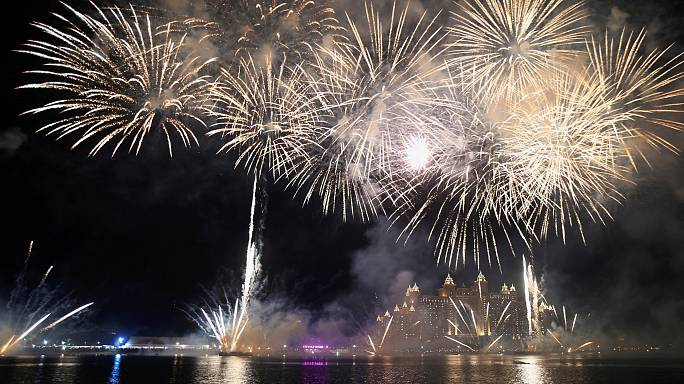 From Dubai to Istanbul, millions welcome in 2017