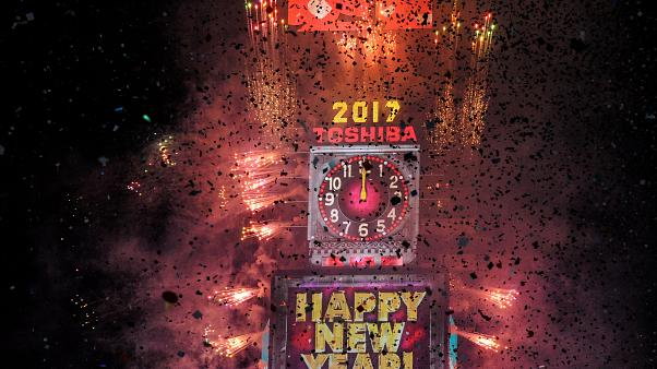 Fireworks and confetti mark the New Year at Times Square