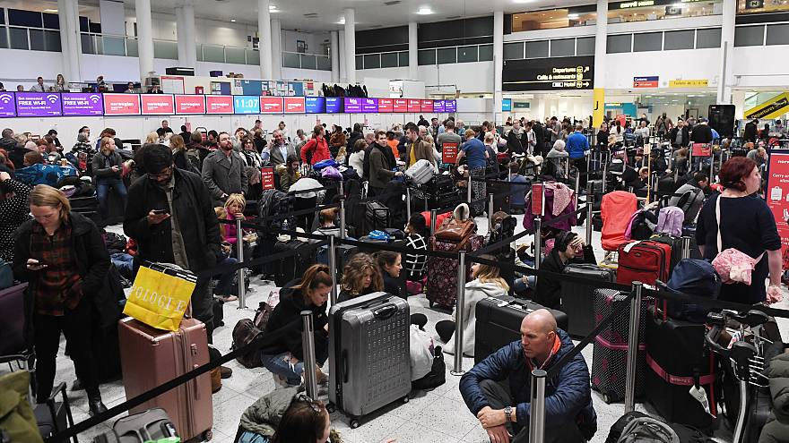 Image:Travelers wait in Gatwick Airport after it was shut down by authoriti