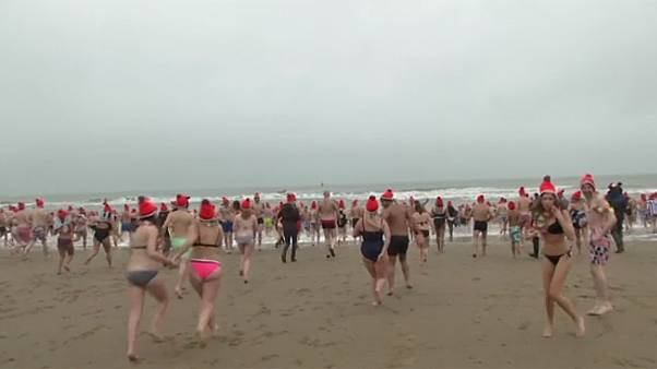 Hundreds take New Year plunge in Dutch seaside town