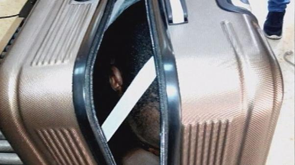 Woman arrested after immigrant is found in a suitcase