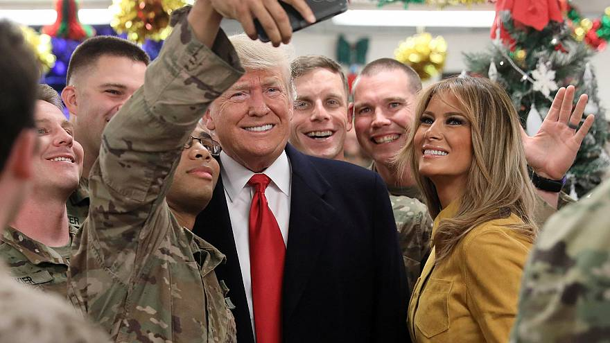 Image: President Donald Trump and First Lady Melania Trump greet military p