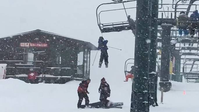 Watch: Ski patrol rescues boy dangling from chairlift