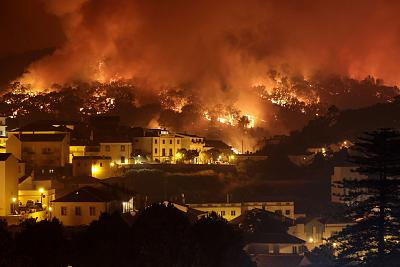 A forest fire burns on a hill in Monchique, Portugal, on Aug. 5.