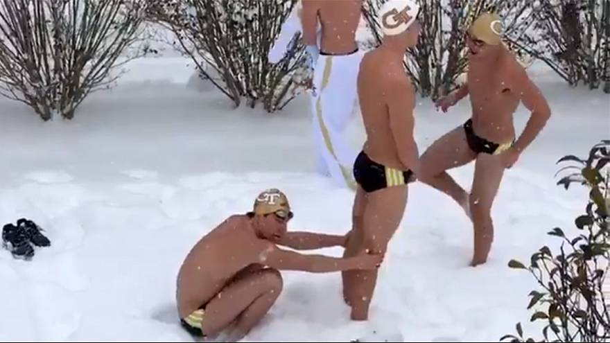Watch: Stranded swimmers take a dip in the snow