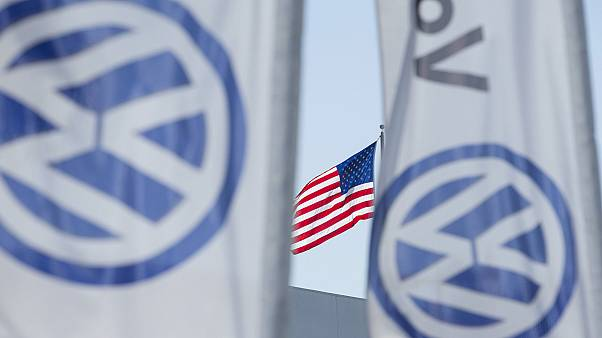 VW exec arrested in US, British drivers sue over emissions scandal
