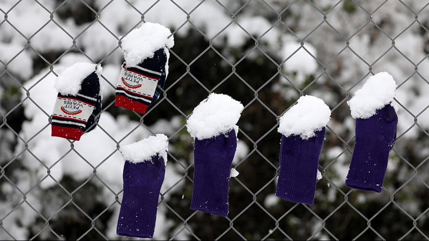 Refugees freezing in snow-hit Greece 'because of lack of EU solidarity'