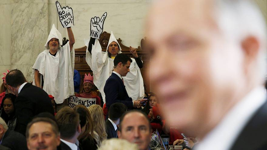 US lawmakers heckled by protesters adorned in KKK outfits