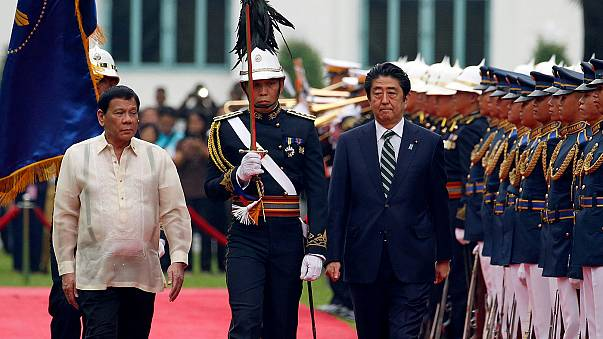 Japan's prime minister makes key visit to Manila