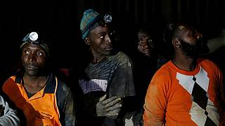 Thousands of South African miners stage sit-in strike 2.4km below ground
