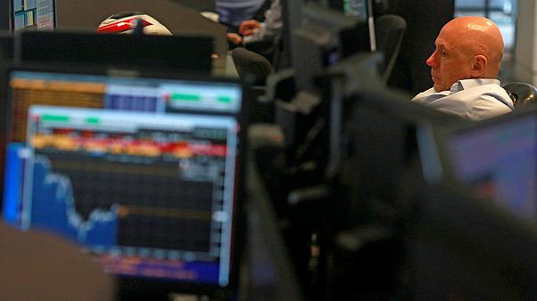 Weak pound boosts FTSE 100 to new record high