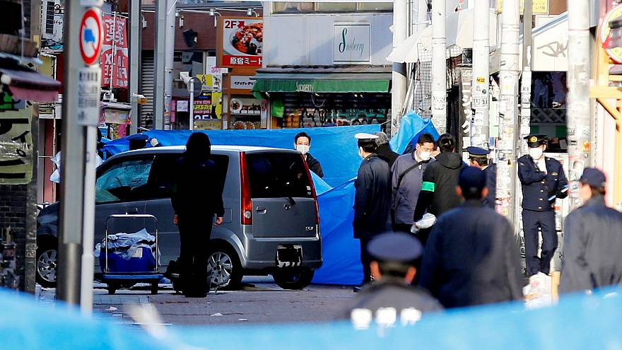 Image: Policemen stand next to a car which plowed into pedestrians on New Y