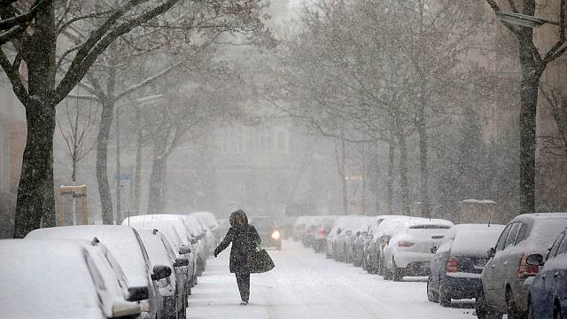 Europe grapples with plunging temperatures, flood threats and heavy snowfall