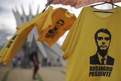 T-shirts featuring the image of Jair Bolsonaro are on sale in Brasilia.