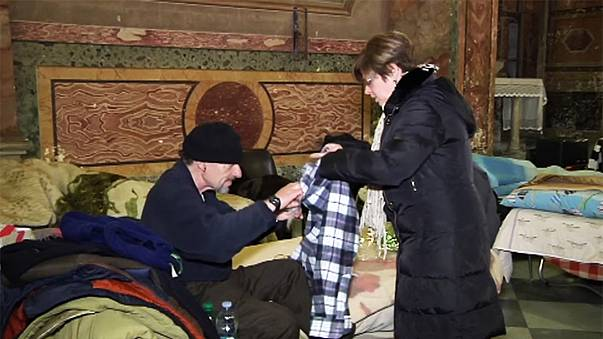 Rome church becomes homeless shelter in freezing weather