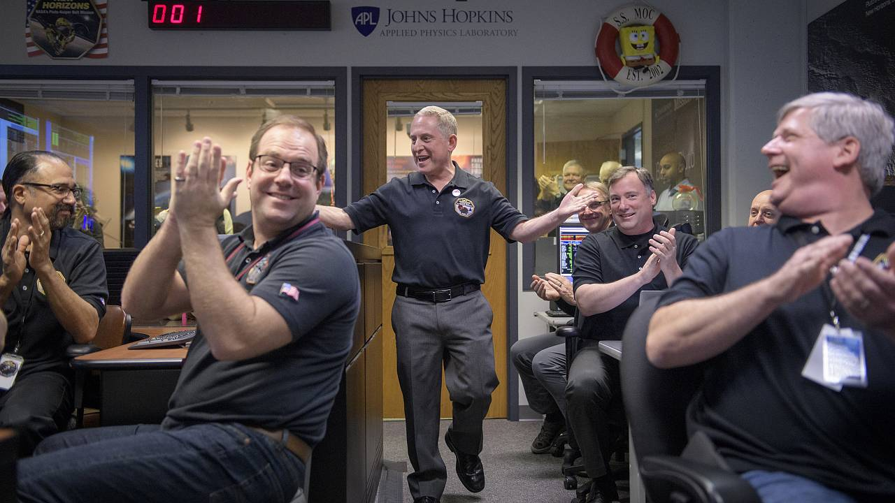 Image: New Horizons principal investigator Alan Stern celebrates with team