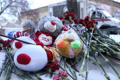 Toys and flowers left at the scene of a collapsed apartment building in Magnitogorsk, Russia.