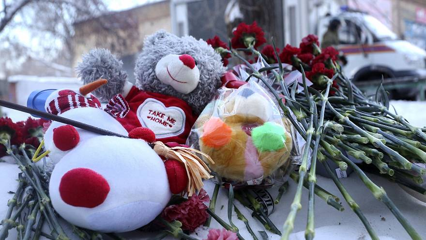 Image: Toys and flowers left at the scene in Magnitogorsk, Russia.