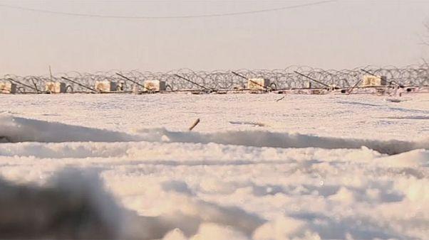 Refugiados atrapados en la nieve
