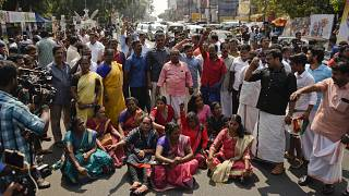 Image: Demonstrators block traffic while protesting reports that two women