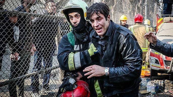 فرق الانقاذ تواصل عمليات إزالة مخلفات انهيار برج بلاسكو في طهران