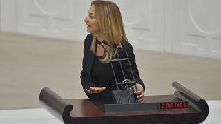 Mayhem in Turkish parliament after MP handcuffs herself to rostrum