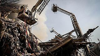 Tehran building collapse: search for missing firefighters