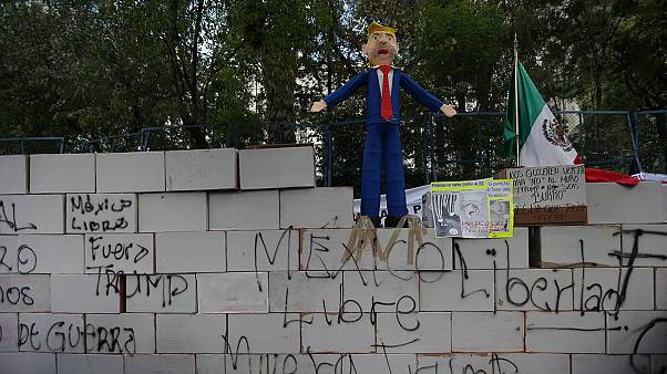 Demonstrators in Mexico City build a wall outside the US embassy